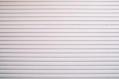 Metal gray shutter door texture, close-up Royalty Free Stock Images