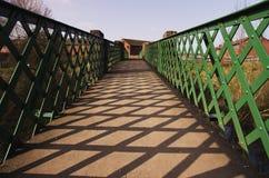 A metal,green footbridge Stock Images