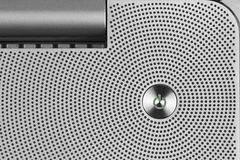 Metal green power IO button on the aluminium perforated surface stock images