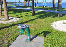 Metal green public water fountain. Next to a beach walkway in St. Petersburg, Florida Royalty Free Stock Photos
