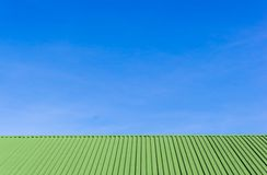 Metal green roof and blue sky Royalty Free Stock Photo