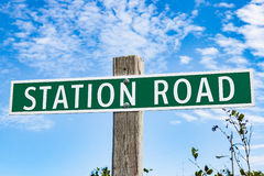 Metal Green Station Road Sign on Wooden Post Royalty Free Stock Photos
