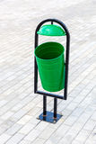 Metal green trash can on the street Royalty Free Stock Photography