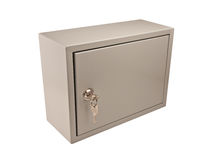 Metal grey box with door, padlock and keys. In the keyhole isolate on white royalty free stock photo