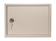 Metal grey box with door, padlock and keys. In the keyhole isolate on white Stock Images