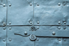 Metal grey surface of old hammered metal plates with rivets and architecture details on them. Stock Photography