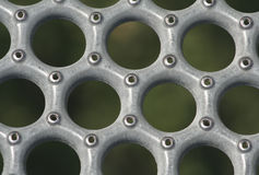 Metal Grid. Close up of a metal grid comprised of circular holes stock photos