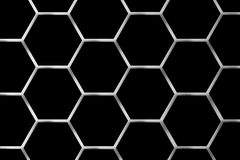 Metal Grid. There is a metal grid on a black background Stock Image