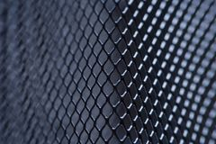Metal grid background, background monochrome. background metal. place for text. Macro gray metallic grid with lighting effects. background monochrome. background royalty free stock photos