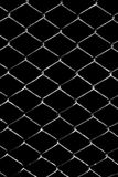 Metal grid on a black background Royalty Free Stock Images