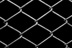 Metal grid on a black background Stock Photos