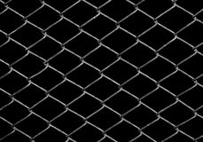 Metal grid on a black background Royalty Free Stock Photography