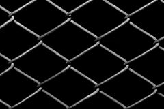 Metal grid on a black background Royalty Free Stock Image