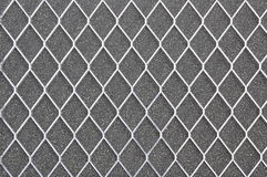 Metal grid on gray background Stock Photo