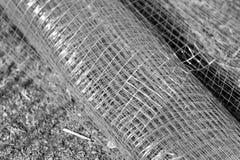 Metal grid on the ground. Monochrome photo Stock Photo