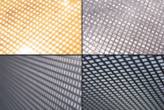 Metal grid grounds. A set of metal grid close-ups with experimental light and perspective Royalty Free Stock Images