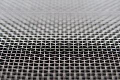 Metal grid macro. Macro of metal wire net abstract background Stock Image