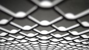 Metal grid net. Movement of the camera along the metal grid net upside down stock video footage