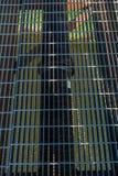 Metal Grid Over Green River Stock Photos
