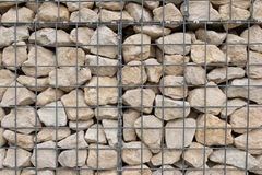 Metal Grid over Rock Royalty Free Stock Photos