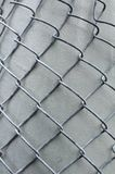 Metal grid overlaid to gray column Royalty Free Stock Images