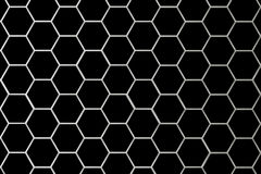 Metal Grid Smaller Cells. There is a metal grid on a black background Royalty Free Stock Image