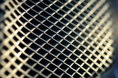 Metal Grid Texture. Metal texture with small grid wholes and pattern shapes stock photos
