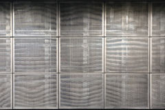 Metal grid tiles on the wall. Stock Photography