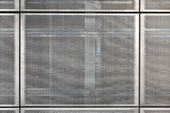 Metal grid tiles on the wall. Stock Photos