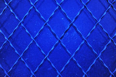 Metal grid on the wall Royalty Free Stock Photography