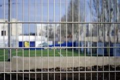 Metal grid. White metal grid near the football field royalty free stock photo