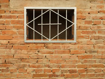 Metal grid in the window Stock Photos