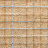 Metal grid and wooden board Stock Photo