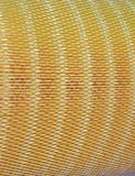 Metal grid on yellow material surface, filter, Stock Photo