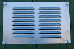 Metal grill background or texture with lines and ridges raised from the surface Royalty Free Stock Photos