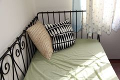 Metal grill bed with cushions Royalty Free Stock Photography