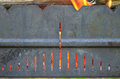 Metal grill with fire Royalty Free Stock Image