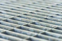 Metal grille in front of door Stock Image
