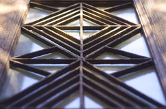 The metal grille in the style of Art Deco on doors of an old house early twentieth century. Window with decorative ornamented iron lattice royalty free stock photography
