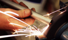 Metal grinder. Sparks flying from a grinding wheel Stock Photos