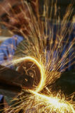 Metal Grinder. Metalworker cutting steel with an angle grinder in a factory Royalty Free Stock Photo