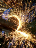 Metal Grinder. Metalworker cutting steel with an angle grinder in a factory Royalty Free Stock Photos
