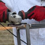 Metal grinding. Grinding a metal frame construction after welding Stock Image