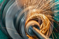Metal grinding, internal grinding with an abrasive wheel on a high-speed spindle of a circular grinding machine.  stock photo