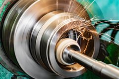 Metal grinding, internal grinding with an abrasive wheel on a high-speed spindle of a circular grinding machine.  stock photos