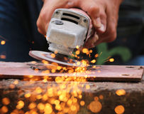 Metal grinding on steel pipe Stock Photography