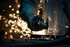Metal grinding on steel pipe with flash of sparks close up. Metal grinding on steel pipe with flash of hot sparks close up Royalty Free Stock Photos