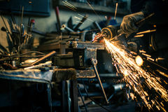 Metal grinding on steel spare part Royalty Free Stock Image