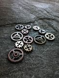 Metal grunge gears. Assorted metal gears on grunge background, foreground is sharp Stock Image