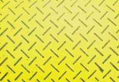 Metal grungy yellow background Stock Photos